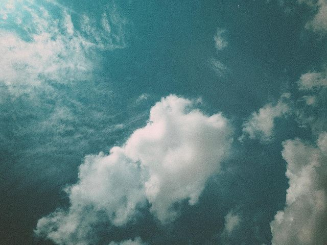 The sky, in a light blue with nothing but white clouds
