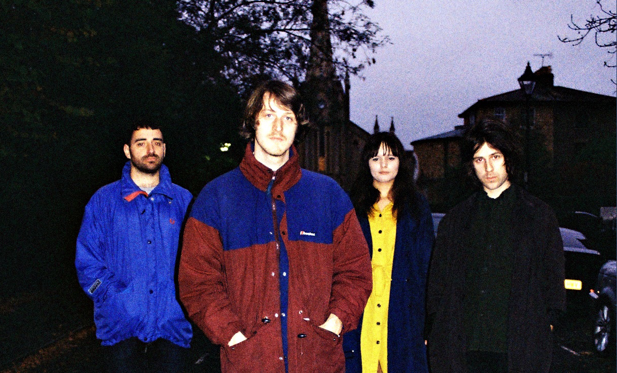The Image shows Pynch four members, wearing colourful jackets in a winterish day in London.